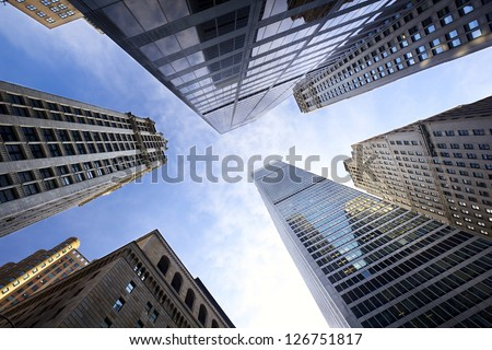 Looking up Lower Manhattan skyscrapers, New York City - stock photo