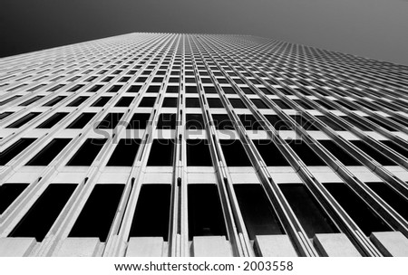Looking up tall building in San Francisco, black and white - stock photo