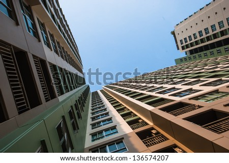 Looking up the sky by side of the condominium - stock photo