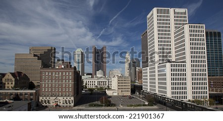 Looking west at the skyline of Columbus, Ohio shows the Statehouse in the middle. - stock photo