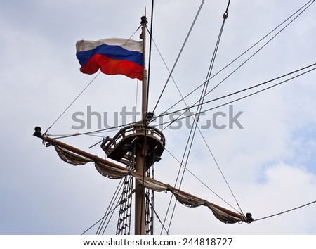 Lookout post in a boat with Russian flag on a gray day - stock photo