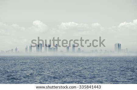 looks like mystique ghost Toronto city background standing in lake Ontario with haze at horizon line  - stock photo
