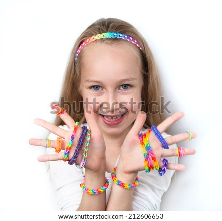 Loom bags craft. Little girl demonstrating her works.   - stock photo