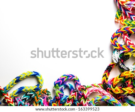 Loom Bracelets on a white background with copyspace. - stock photo