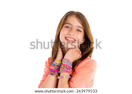 Loom rubber bands bracelets blond kid girl smiling hands in neck on white background - stock photo