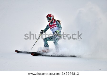 LOON MOUNTAIN USA - JANUARY 24: Tina Sutton Memorial - Slalom Ski Competition. Unidentified participant of junior ski race on January 24, 2016 at the Loon Mountain in New Hampshire, USA   - stock photo