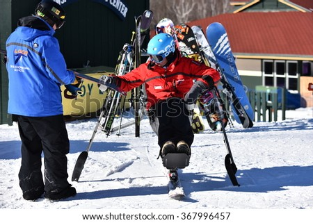 LOON MOUNTAIN USA - JANUARY 24: Tina Sutton Memorial - Slalom Ski Competition. Unidentified disabled skier attend to junior ski race on January 24, 2016 at the Loon Mountain in New Hampshire, USA   - stock photo