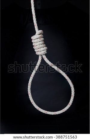 loop of rope for hanging  on black  background  with clipping path for concept of suicide , depression,or failure in life - stock photo
