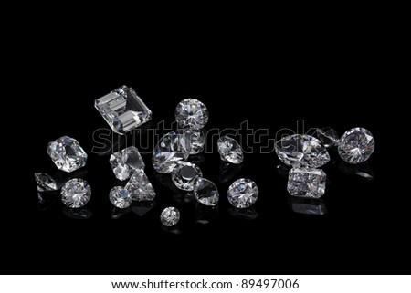 Loose diamond parcel on black background - stock photo