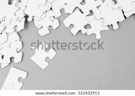 Loose jigsaw puzzle pieces - stock photo