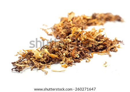 loose tobacco, blend of light and dark varieties, closeup isolated on white background - stock photo