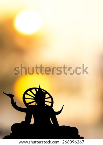 Lord silhouette on the sunset background blurred. - stock photo