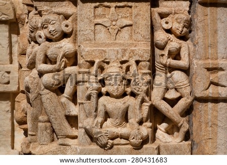 Lord Vishnu and dancing women on bas-relief of historical hindu temple - stock photo