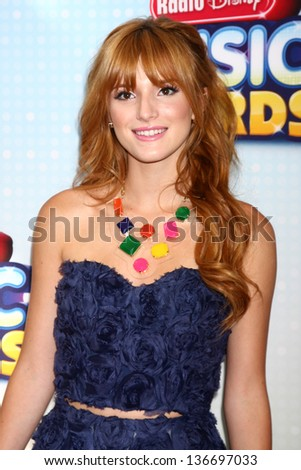 LOS ANGELES - APR 27:  Bella Thorne arrives at the Radio Disney Music Awards 2013 at the Nokia Theater on April 27, 2013 in Los Angeles, CA - stock photo