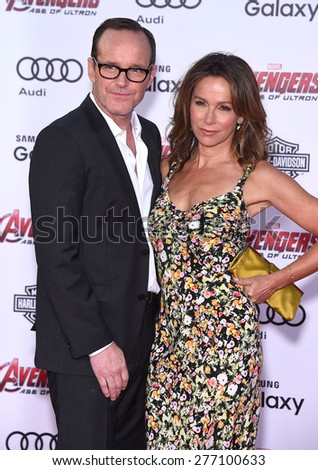 "LOS ANGELES - APR 14:  Clark Gregg & Jennifer Grey arrives to the Marvel's ""Avengers: Age of Ultron"" World Premiere  on April 14, 2015 in Hollywood, CA                 - stock photo"