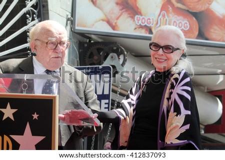 LOS ANGELES - APR 28:  Ed Asner, Barbara Bain at the Bairbara Bain Hollywood Walk of Fame Star Ceremony at the Hollywood Walk of Fame on April 28, 2016 in Los Angeles, CA - stock photo