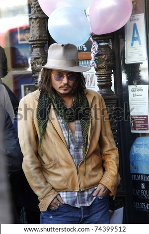 LOS ANGELES - APR 01: Johnny Depp at a ceremony where Penelope Cruz is honored with a star on the Hollywood Walk of Fame on April 1, 2011 in Los Angeles, California. - stock photo