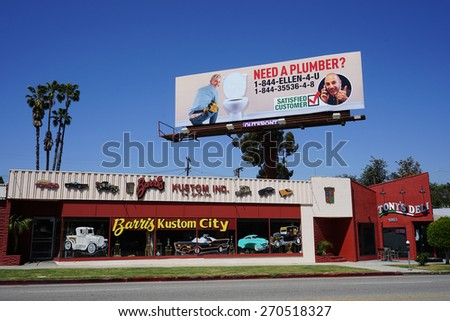 LOS ANGELES - APR 17: Matt Lauer pranks Ellen DeGeneres with a huge billboard in which she is shown as a plumber on April 17, 2015 in Los Angeles, California - stock photo