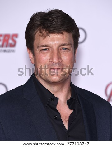 "LOS ANGELES - APR 14:  Nathan Fillion arrives to the Marvel's ""Avengers: Age of Ultron"" World Premiere  on April 14, 2015 in Hollywood, CA                 - stock photo"