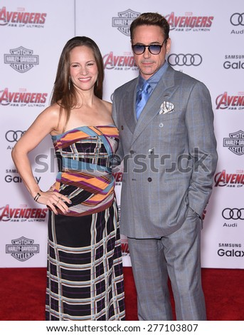 "LOS ANGELES - APR 14:  Robert Downey Jr & Susan Downey arrives to the Marvel's ""Avengers: Age of Ultron"" World Premiere  on April 14, 2015 in Hollywood, CA                 - stock photo"