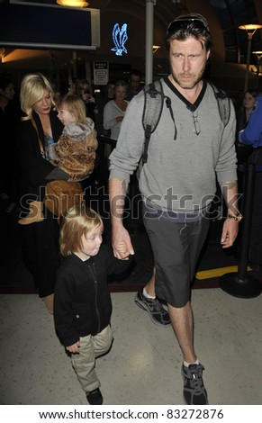 LOS ANGELES-APRIL 8: Actress Tori Spelling with husband Dean and kids at LAX airport. April 8 in Los Angeles, California 2011 - stock photo
