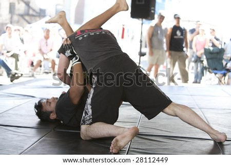 LOS ANGELES - APRIL 5:  Members of Torrance's IMB Academy show Mixed Martial Arts (MMA) at the Little Tokyo Cherry Blossom Festival on April 5th, 2009 in Los Angeles. - stock photo