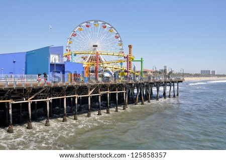 LOS ANGELES - April 11: The amusement park on the Santa Monica Pier in Santa Monica, California on April 11, 2011. A popular tourist attraction. - stock photo