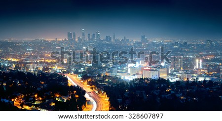 Los Angeles at night with urban buildings and highway - stock photo