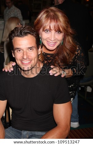 """LOS ANGELES - AUG 4:  Antonio Sabato Jr, mother appearing at the """"Hollywood Show"""" at Burbank Marriott Convention Center on August 4, 2012 in Burbank, CA - stock photo"""