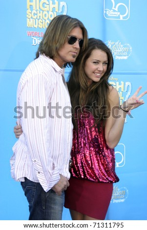 "LOS ANGELES - AUG 14:  Billy Ray & Miley Cyrus arrive at the ""High School Musical 2"" Premiere at AMC Theaters - Downtown Disney on August 14, 2007 in Los Angeles, CA - stock photo"