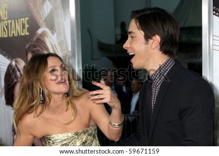 """LOS ANGELES - AUG 23:  Drew Barrymore & Justin Long arrives at the """"Going the Distance"""" Los Angeles Premiere at Grauman's Chinese Theater on August 23, 2010 in Los Angeles, CA - stock photo"""