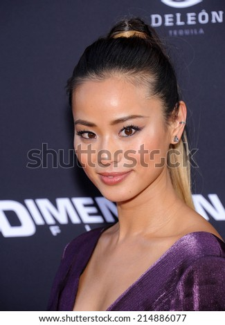 """LOS ANGELES - AUG 19:  Jamie Chung arrives to the """"Sin City: A Dame To Kill For"""" Los Angeles Premiere  on August 19, 2014 in Hollywood, CA                 - stock photo"""