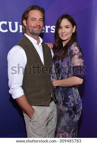 LOS ANGELES - AUG 12:  Josh Holloway & Sarah Wayne Callies arrives to the arrives to the Summer 2015 TCA's - NBCUniversal  on August 12, 2015 in Beverly Hills, CA                 - stock photo