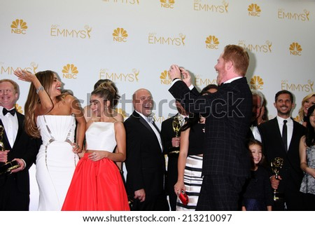 LOS ANGELES - AUG 25:  Sofia Vergara, Jesse Tyler Ferguson at the 2014 Primetime Emmy Awards - Press Room at Nokia Theater at LA Live on August 25, 2014 in Los Angeles, CA - stock photo