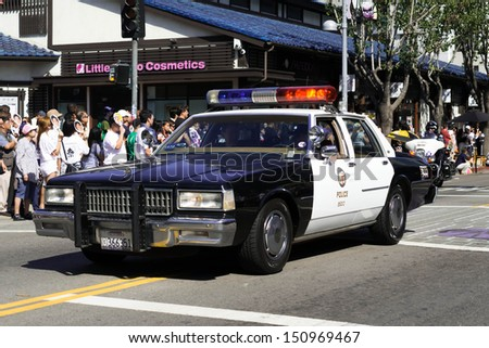 LOS ANGELES - AUGUST 11:  Old police car in the 73th Annual Nisei Week Grand Parade - August 11, 2013 in downtown Los Angeles, CA. - stock photo