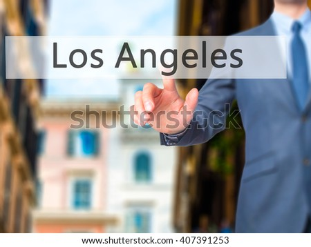 Los Angeles - Businessman hand pressing button on touch screen interface. Business, technology, internet concept. Stock Photo - stock photo