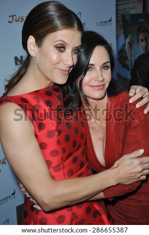 """LOS ANGELES, CA - APRIL 20, 2015: Courteney Cox & Kate Walsh (left) at the premiere of their movie """"Just Before I Go"""" at the Arclight Theatre, Hollywood.  - stock photo"""