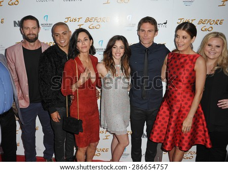 """LOS ANGELES, CA - APRIL 20, 2015: Garret Dillahunt (left), Evan Ross, Courteney Cox, Olivia Thirlby, Seann William Scott, Kate Walsh & Mackenzie Marsh at the premiere of  """"Just Before I Go"""".  - stock photo"""