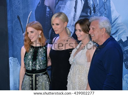 """LOS ANGELES, CA. April 11, 2016: Jessica Chastain, Charlize Theron, Emily Blunt & producer Joe Roth at the US premiere of """"The Huntsman: Winter's War"""" at the Regency Village Theatre, Westwood. - stock photo"""