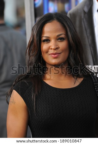"LOS ANGELES, CA - APRIL 7, 2014: Laila Ali, daughter of Muhammed Ali, at the Los Angeles premiere of ""Draft Day"" at the Regency Village Theatre, Westwood.  - stock photo"