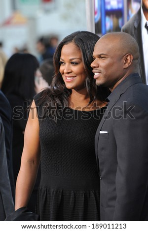 "LOS ANGELES, CA - APRIL 7, 2014: Laila Ali, daughter of Muhammed Ali, & husband Curtis Conway at the Los Angeles premiere of ""Draft Day"" at the Regency Village Theatre, Westwood.  - stock photo"