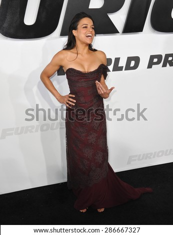 """LOS ANGELES, CA - APRIL 1, 2015: Michelle Rodriguez at the world premiere of her movie """"Furious 7"""" at the TCL Chinese Theatre, Hollywood.  - stock photo"""