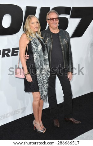 """LOS ANGELES, CA - APRIL 1, 2015: Peter Fonda & wife Parky Fonda at the world premiere of """"Furious 7"""" at the TCL Chinese Theatre, Hollywood. April 1, 2015  Los Angeles, CA  - stock photo"""