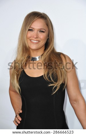 "LOS ANGELES, CA - APRIL 1, 2015: Ronda Rousey at the world premiere of her movie ""Furious 7"" at the TCL Chinese Theatre, Hollywood. April 1, 2015  Los Angeles, CA  - stock photo"