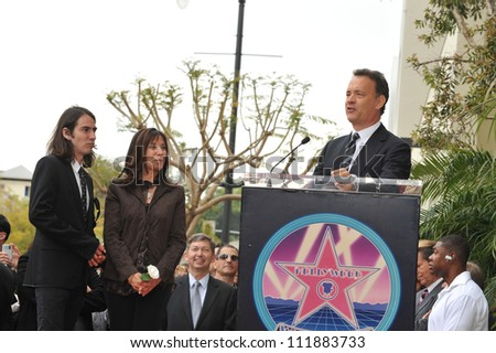LOS ANGELES, CA - APRIL 14, 2009: Tom Hanks with Olivia Harrison & son Dhani Harrison at Hollywood Walk of Fame star ceremony honoring the late George Harrison. - stock photo
