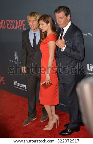 "LOS ANGELES, CA - AUGUST 17, 2015: Lake Bell with Owen Wilson (left) & Pierce Brosnan at the Los Angeles premiere of their movie ""No Escape"" at the Regal Cinemas LA Live. 