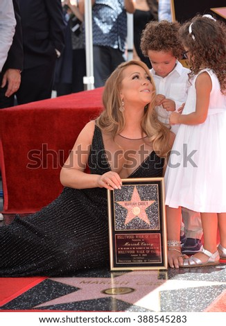 LOS ANGELES, CA - AUGUST 5, 2015: Mariah Carey & her twins Morocco & Monroe Cannon on Hollywood Boulevard where she was honored with the 2,556th star on the Hollywood Walk of Fame. - stock photo
