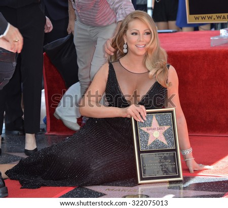 LOS ANGELES, CA - AUGUST 5, 2015: Mariah Carey on Hollywood Boulevard where she was honored with the 2,556th star on the Hollywood Walk of Fame. - stock photo