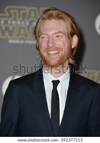 """LOS ANGELES, CA - DECEMBER 14, 2015: Actor Domnhall Gleeson at the world premiere of """"Star Wars: The Force Awakens"""" on Hollywood Boulevard - stock photo"""