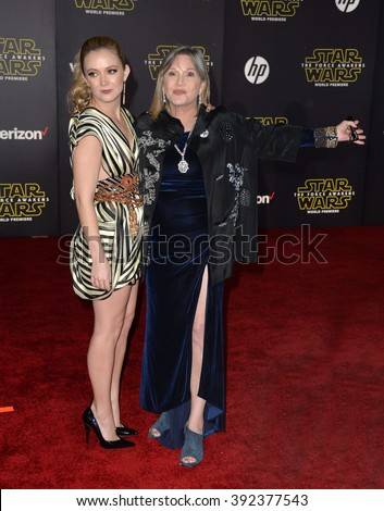 """LOS ANGELES, CA - DECEMBER 14, 2015: Actress Carrie Fisher & daughter Billie Lourd at the world premiere of """"Star Wars: The Force Awakens"""" on Hollywood Boulevard - stock photo"""